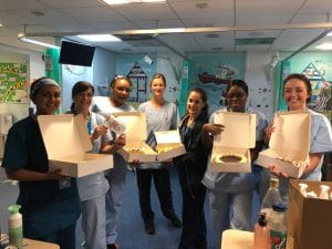 RBH staff receiving Cocolico cakes